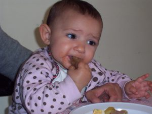 This baby is also about 8 months old. He is eating meat. And why not?